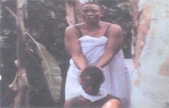 Mrs. Amuka Pemu Holding the Boy Before the alleged killing {PointBlankNews}
