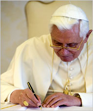 "Pope Benedict XVI signing his encyclical ""Charity in Truth"" at the Vatican on Monday. {NYTimes}"